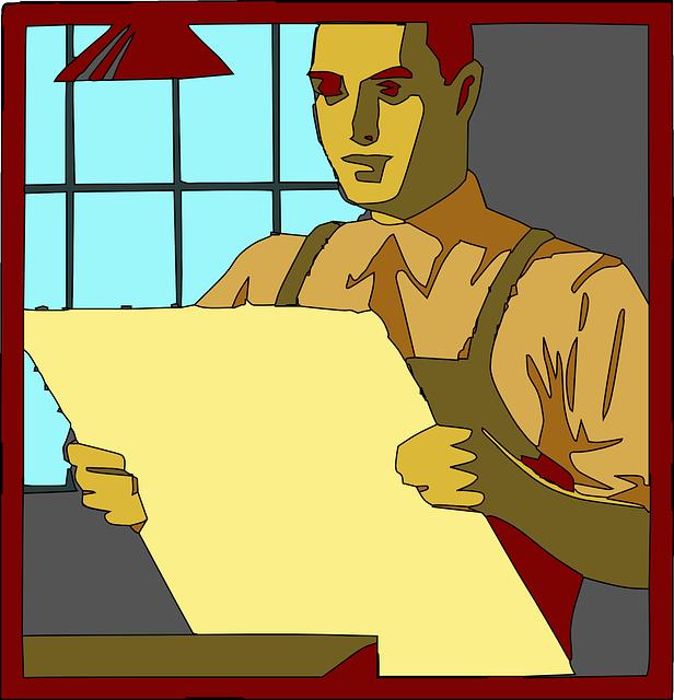 pracovník zkoumá výkresy